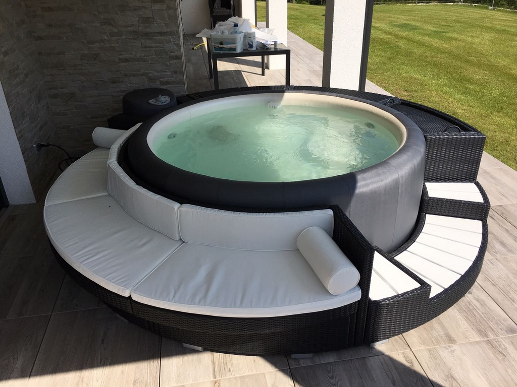 Softub hot tub with curved seating and cushions