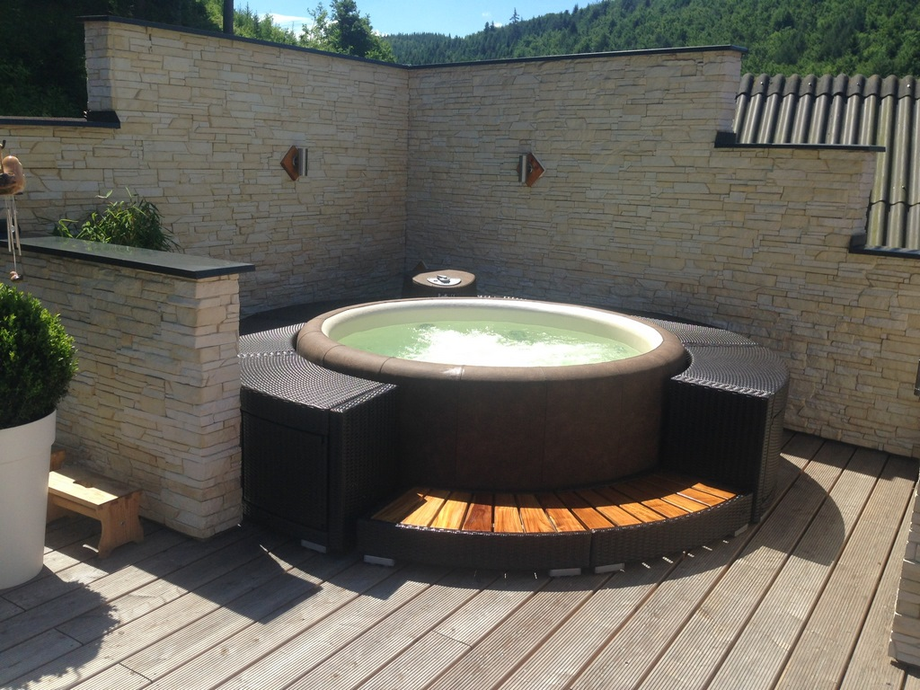 Softub hot tub in walled courtyard