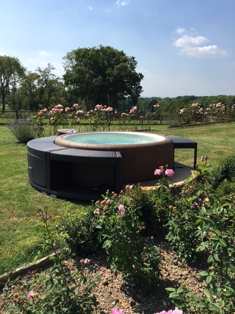 Softub hot tub in rose garden