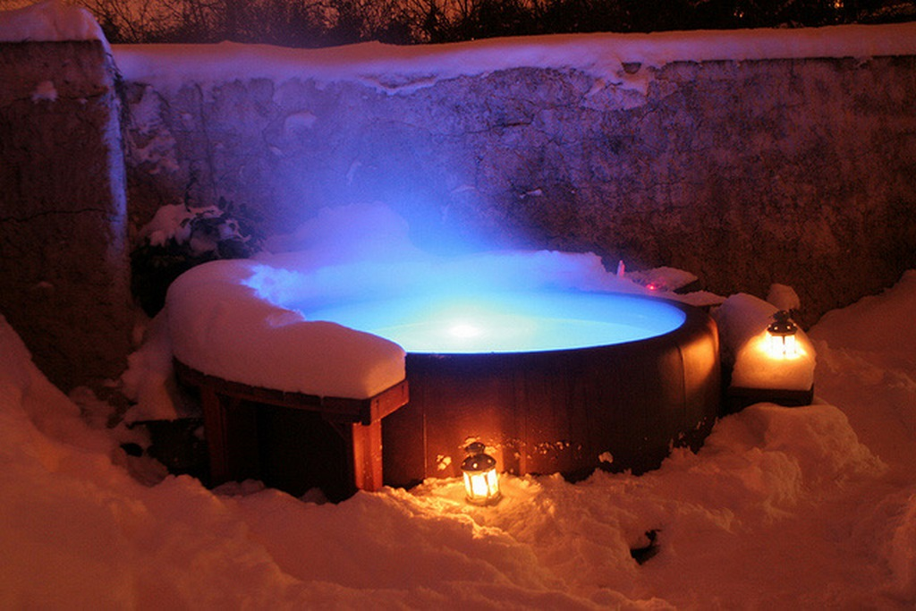 snow and steam on our Softub hot tub